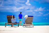 Lounge chairs with bag and hat on tropical white beach — Стоковое фото