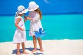 Adorable little girls having fun during beach vacation — Stock Photo