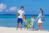 Happy family during summer vacation on white beach — Stock Photo