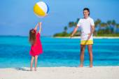 Happy father and daughter playing with ball having fun outdoor on beach — Stock Photo