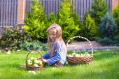 Little girl with baskets full of tomatoes — Stock Photo