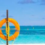 Lifebuoy ring on tropical white beach — Stock Photo #75861929