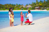 Young family having fun on beach — Stock Photo