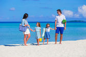 Happy beautiful family on a tropical beach holiday — Stock Photo