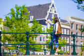 Young woman tourist taking self portrait selfie photo on Europe travel in Amsterdam city — Stock Photo