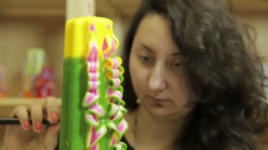 Girl on candle factory — Stock Video