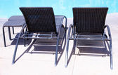Beach chairs by the pool — Stock Photo