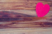 Heart on the wood background — Stockfoto