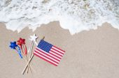 American flag with stars on the sandy beach — Stock Photo