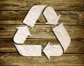 Recycle sign on wood background — Stock Photo