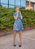 Young girl blonde in blue short dress — Stock Photo