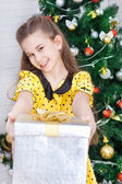 Girl with the packaged gift — Stock Photo