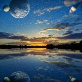 Sunset over the lake on a sky background with planets — Stock Photo