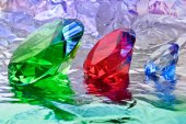 Precious stones,jewelry on the background of silver foil — Stock Photo