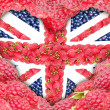 The Union Jack in the shape of a heart on a background of raspberry. — Stock Photo #53610361