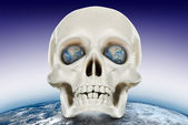 The human skull on a background of the planet earth. — Stock Photo