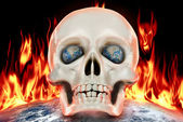 The human skull on a background of planet earth in fire. — Stock Photo