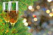 Two glasses of wine under the Christmas tree — Stock Photo