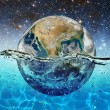 Постер, плакат: Planet Earth is submerged in water on the background of the starry sky