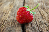 Ripe red strawberries on a wooden background — Photo