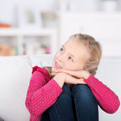 Little girl at home looking up — Stockfoto
