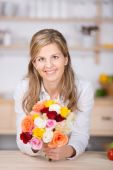 Woman holding fresh flower at home — Stock Photo