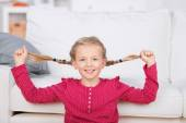 Girl pulling her pigtails — Stock Photo