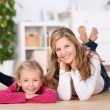 Mother and little daughter lying — Stock Photo #52303089