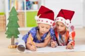 Two kids writing wishlist — Stock Photo