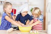 Sisters making dough in bowl — Stock Photo
