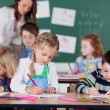 Children studying in kindergarten school — Stock Photo #53241145