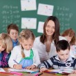 Female teacher in kindergarten — Stock Photo #53241757