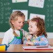 Two happy little girls in school — Stock Photo #53241785