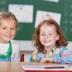 Two happy little girls in kindergarten — Stock Photo #53242003