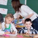 Female teacher in kindergarten class — Stock Photo #53242213