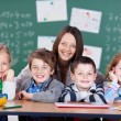 Teacher with her students — Stock Photo #53246429