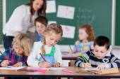 Children studying in kindergarten school — Stock Photo