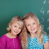 Two young friends in school — Stock Photo