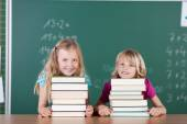 Girls with books in school — Stock Photo