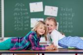 Girls in school classroom — Stock Photo