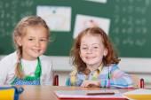 Two happy little girls in kindergarten — Stock Photo
