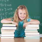 Blond girl in school with her books — Stock Photo