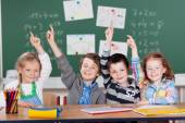 Schoolchildren raising their hands — Foto Stock