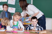 Female teacher in kindergarten class — Stock Photo