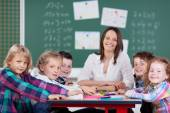 Female teacher leading class activity — Stock Photo