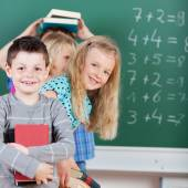 Mischievous children on primary school — Stock Photo
