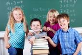 Boys and girls in school with books — Stock Photo