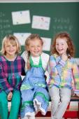 Laughing playful girls in school — Stock Photo