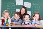 Teacher with her students — Stock Photo
