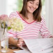 Woman smiling as she reads good news — Stock Photo #54599117
